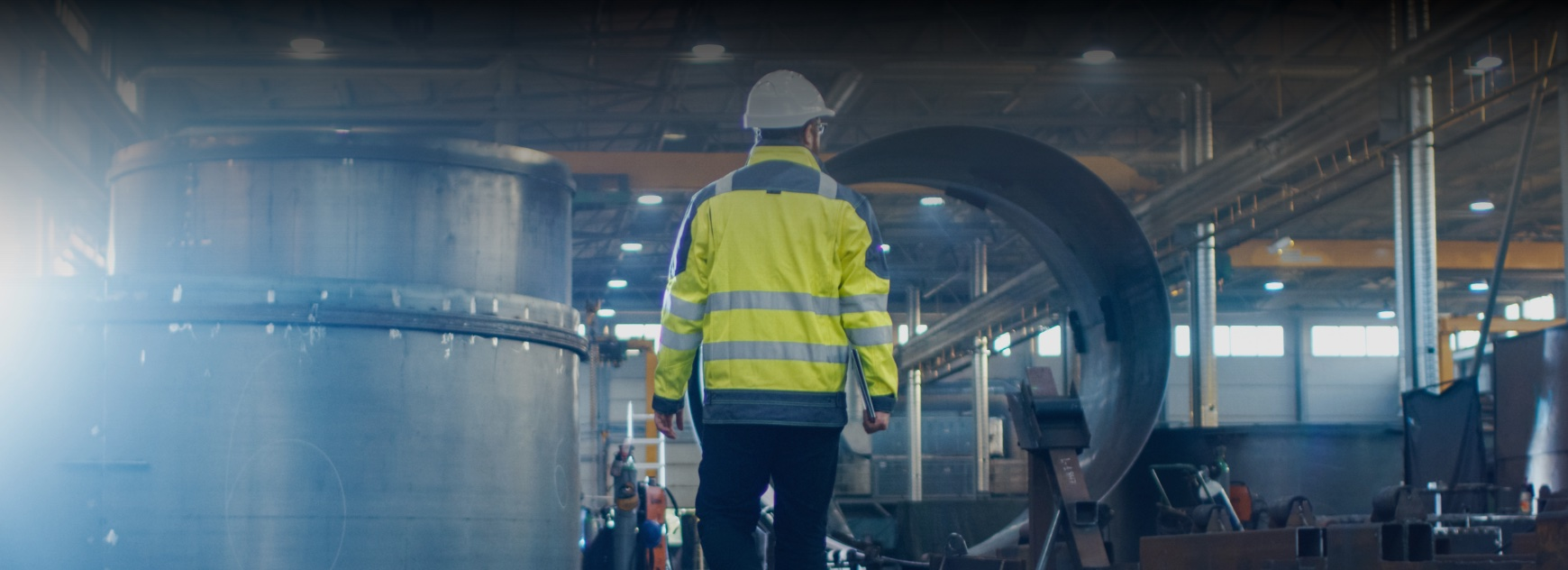 engineer walking through industrial factory